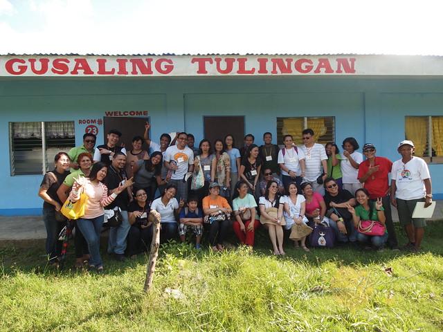 Lakbay Pag-Asa participants group hug at the 2 classrooms World Vision help build
